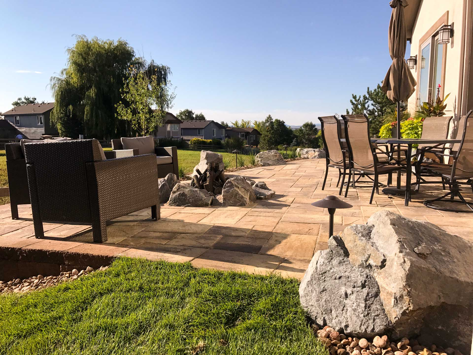 Grant Ranch patio table & firepit overlooking the back lawn
